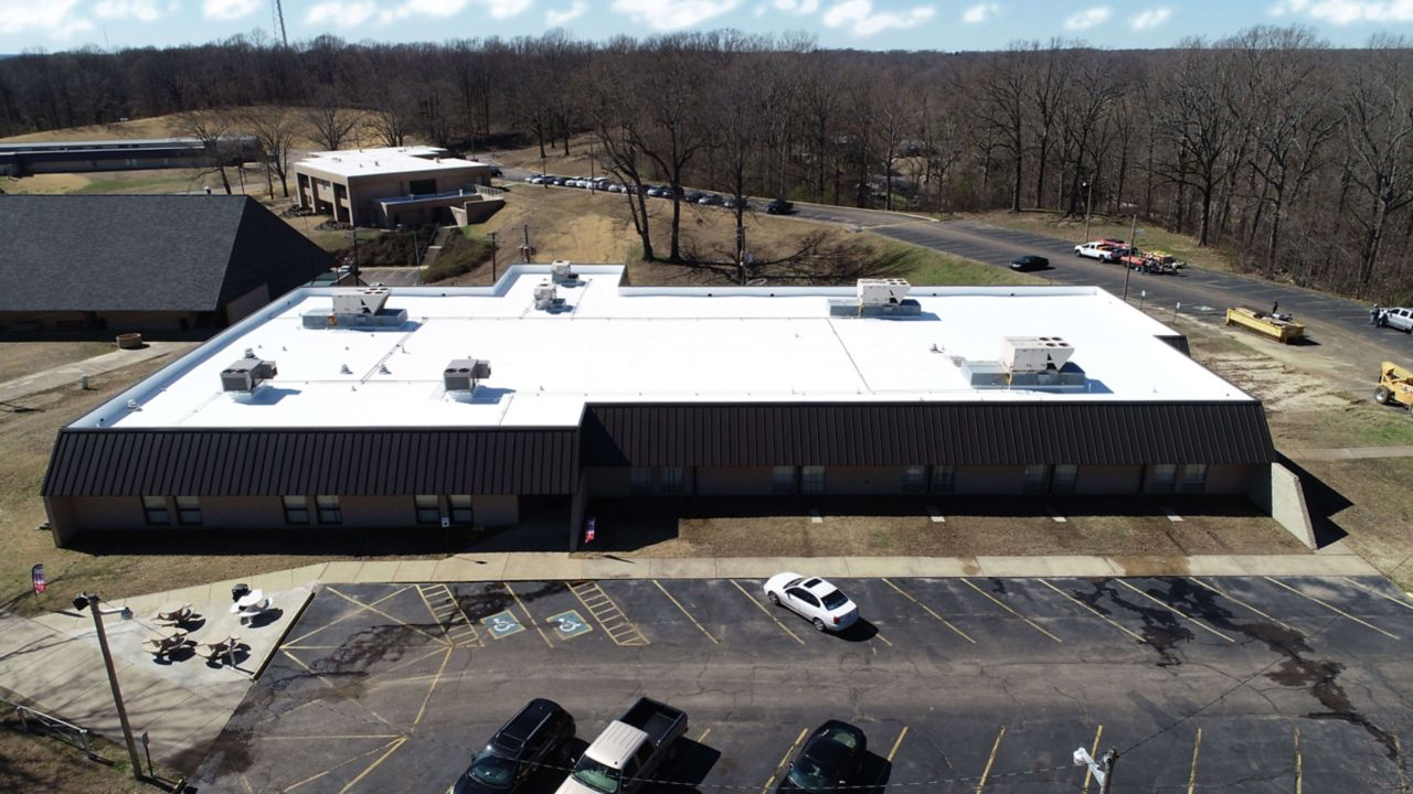 Ariel view of phillips commnunity college with a white membrane roof