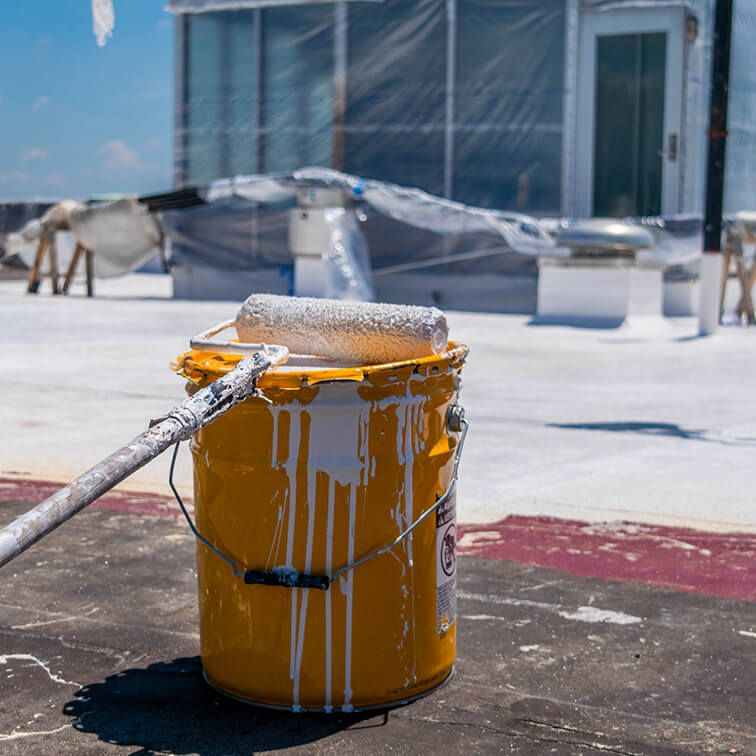 Rooftop with bucket of Sikalastic Resin
