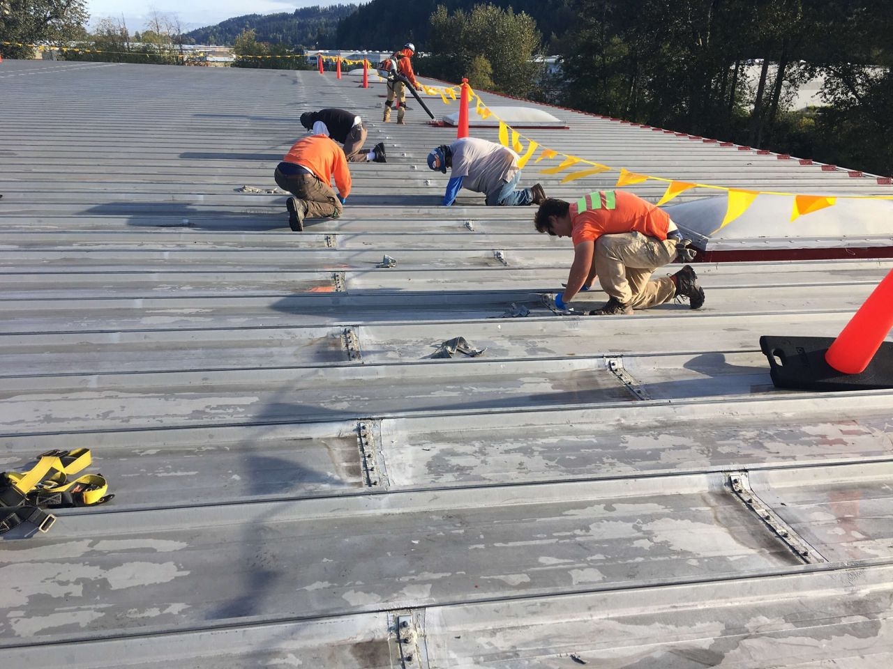 roof contractors working on a flat roof