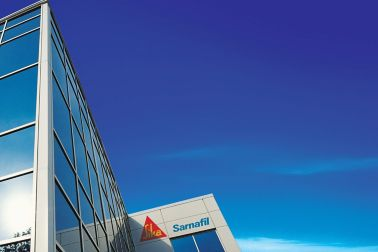 Exterior of a building with the Sika Sarnafil logo