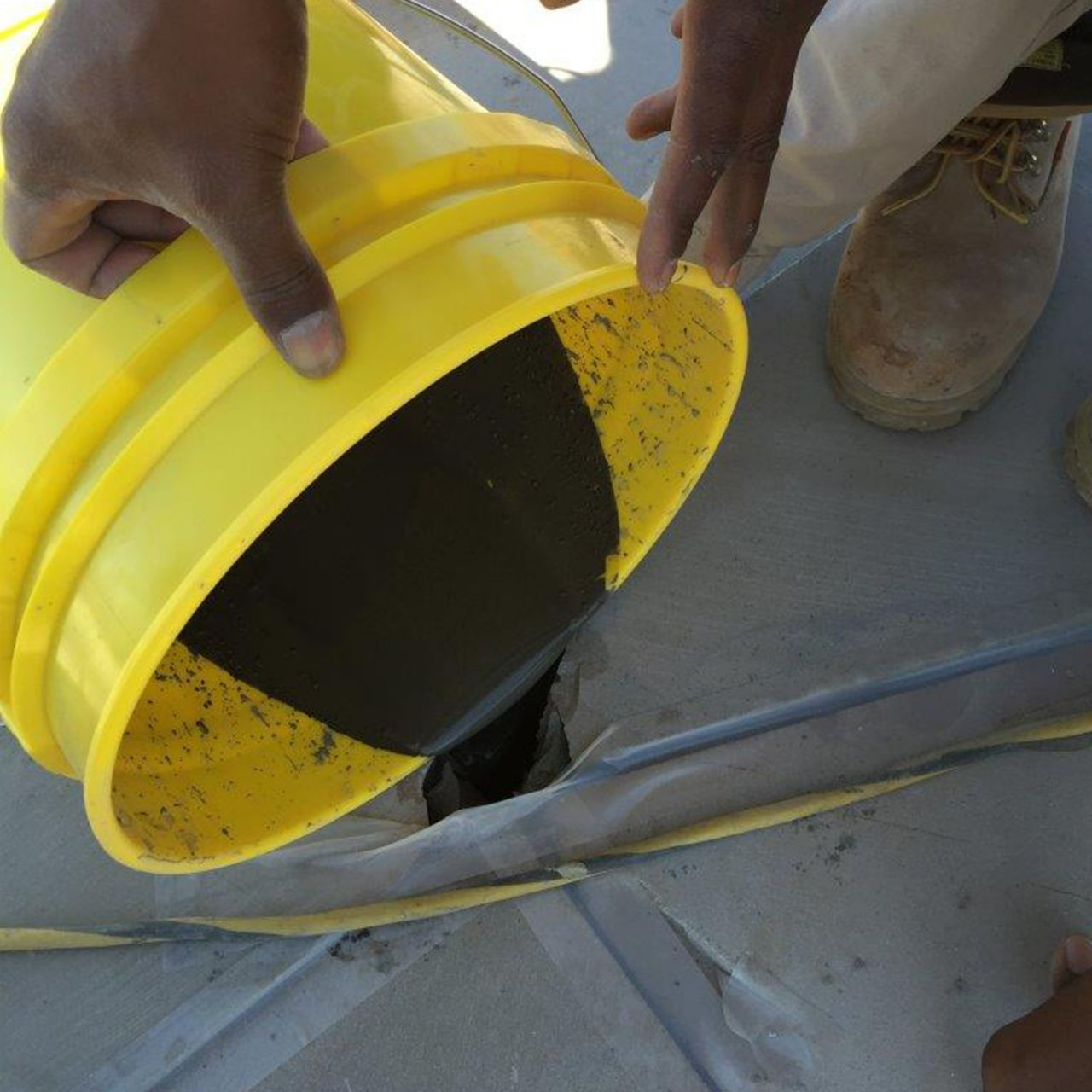 emptying bucket filling a grout