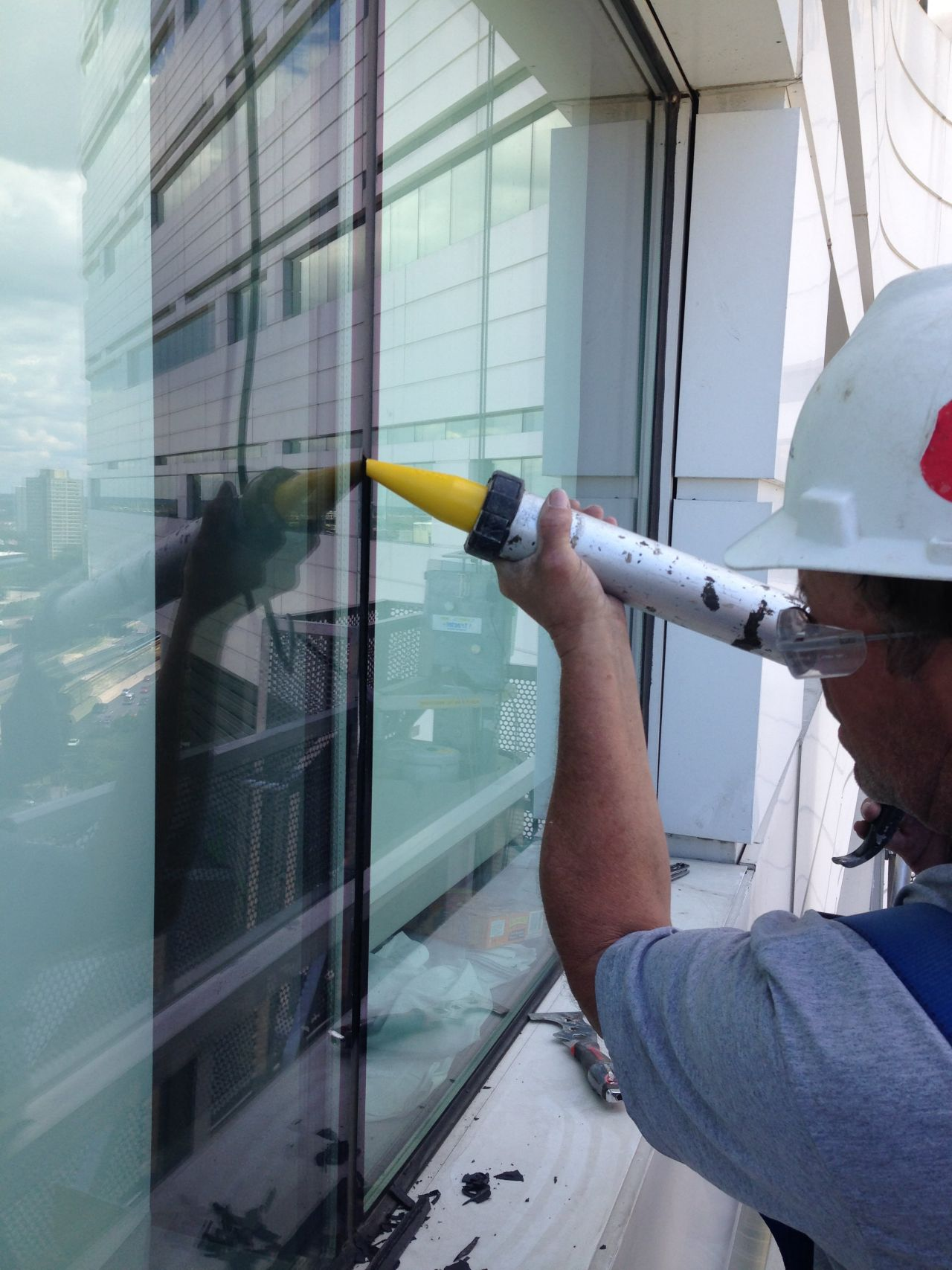 Silicone Joint Sealant Application to Exterior Window on Building