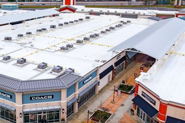 White Sarnafil membrane roof on the top of the Tanger Outlets in Sunburg Ohio