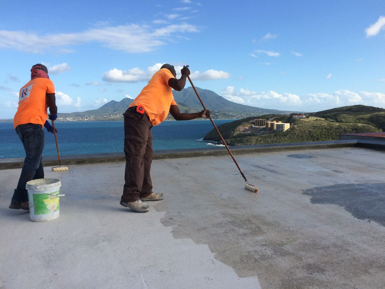 Concrete primer being applied on roof
