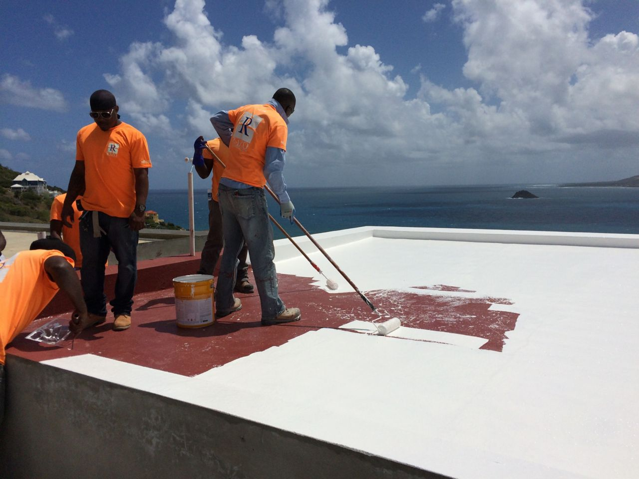 sikalastic 621 Top Coat being applied on roof