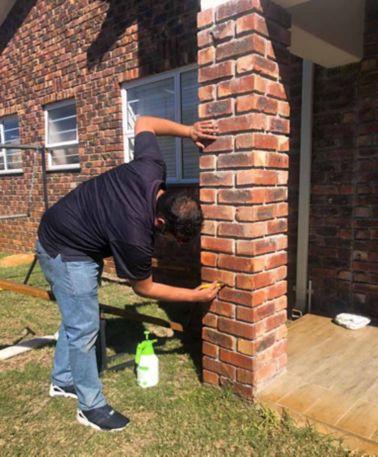 Applying Sikagard-703 W to brick wall