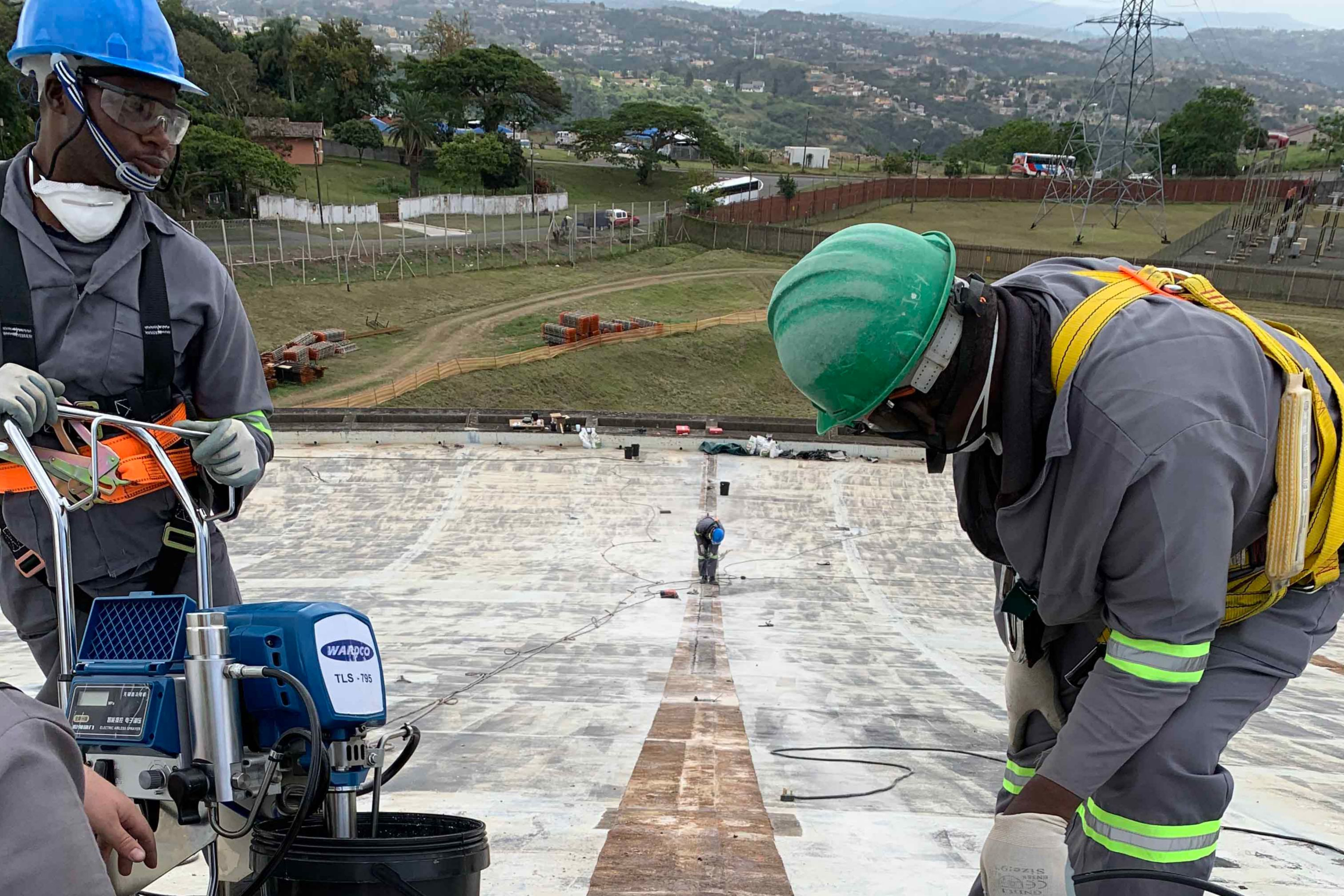 Men at work on Durban Heights Reservoir's roof panels, situated in Reservoir Hills, KZN.